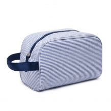 The Coral Palms® Simply Seersucker Travel Cosmetic Bag - NAVY